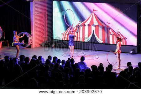 Yalta, Crimea - 11 July, Group of girls with hoops, 11 July, 2017. Performance of young artists on the stage of the hotel Yalta Intourist.
