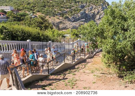Yalta, Crimea - 11 July, Groups of tourists on the stairs, 11 July, 2017. Small Castle Lastochkino Nest and its surroundings.