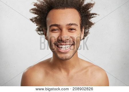 Positive Human Emotions Concept. Handsome Young Man Laughs Gladfully, Shows Perfect White Teeth, Has