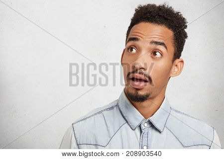 Horizontal Shot Of Astonished Hipster Male With Trendy Hairstyle, Hazel Eyes, Beard And Mustache Loo