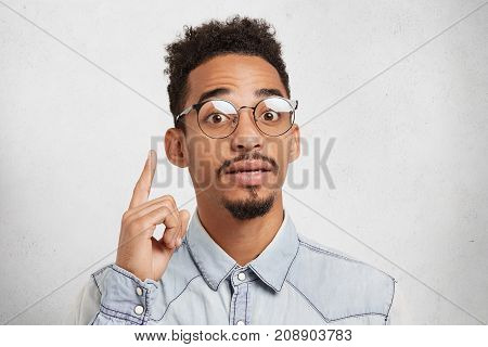 I Get Great Idea. Confident Mixed Race Male Scientist Wears Roung Glasses, Has Mustache And Beard, R