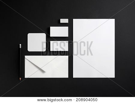 Blank stationery and corporate identity template on black background. Mock-up for ID. Top view.