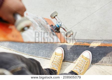 Extreme Sport And Healthy Lifestyle Concept. Unrecognizable Man Wears Sneakers Or Training Shoes, Ho