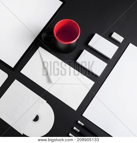 Brand identity template. Photo of blank corporate stationery set on black background.