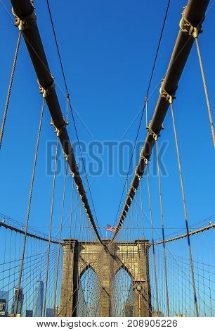 The Brooklyn Bridge is a hybrid cable-stayed/suspension bridge in New York City and is one of the oldest bridges in the United States