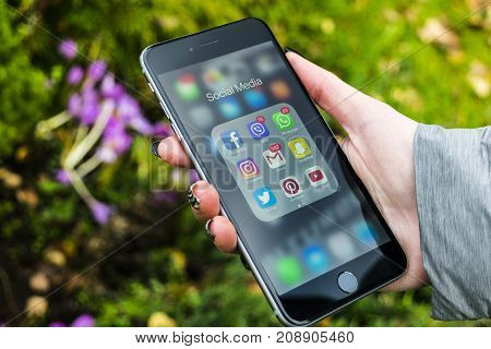 Sankt-Petersburg Russia October 13 2017: iphone 6 plus with icons of social media in girl hands. Smartphone life style smartphone. Starting social media app.