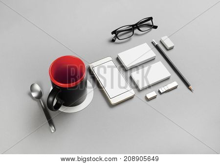 Blank corporate stationery and gadgets on gray paper background. Brand ID elements for placing your design.