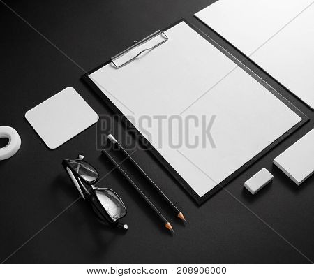 Corporate stationery mockup. Branding ID elements. Blank objects on black paper background.
