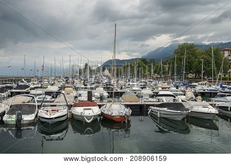 MONTREUX, SWITZERLAND - September 02: yacht parking on Montreux Riviera at Lake Geneva in the early morning on a cloudy day, Montreux, Switzerland on September 02, 2017