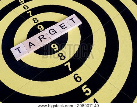 Closeup of word spell TARGET on dart board (Business Concept)