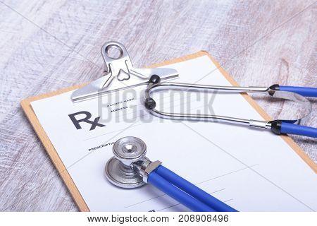 Closeup of medical stethoscope on a rx prescription.