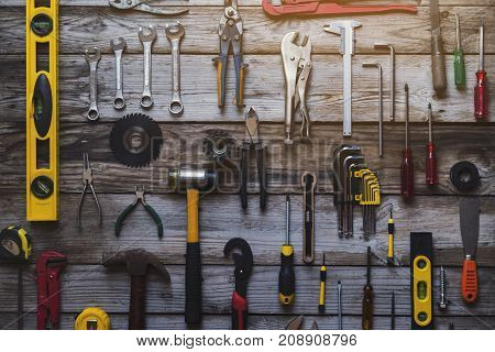 Old tools equipment with blackboard on wood table background engineering concept