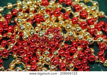 pineapples golden pearls and red bows and Christmas bells
