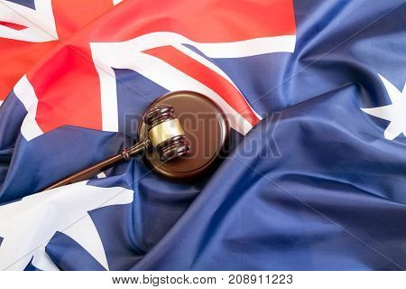 Gavel And Legal Book On Wooden Table, Collage With Flag Of Australia
