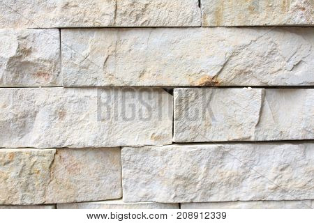 A white and grey brick wall. uneven surface. brick texture.