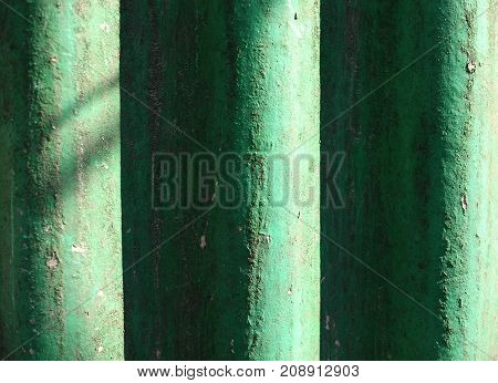 Sunlit Green Painted Wavy Slate Background. Shabby Dusty Wavy Slate Texture