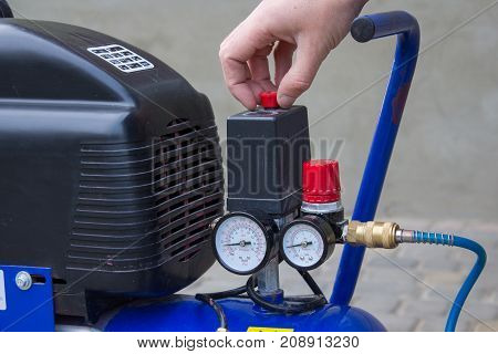 Starting the air compressor with your hand in the yard