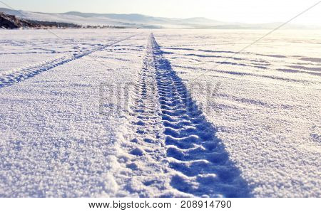 Tyre tracks in the snow on lake Baikal ice surface