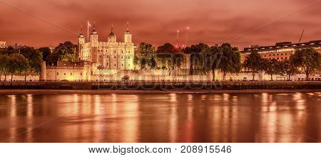 London, the United Kingdom: the Tower from the River Thames at night