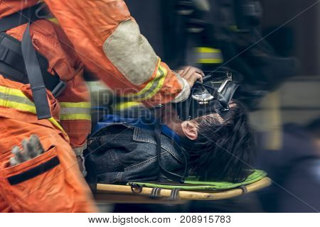 Running blurry paramedic carrying patient on stretcher