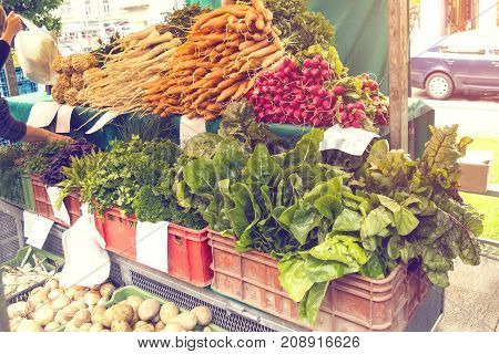 Fresh organic produce at the local farmers market. Farmers ' markets are a traditional way of selling agricultural products. the horizontal frame.