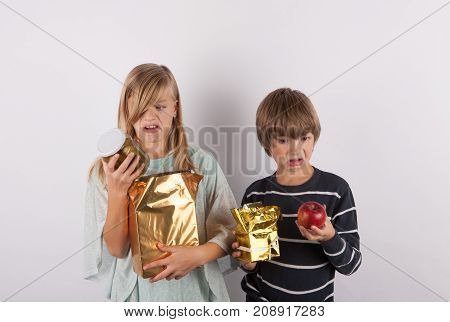 Two Children shocked by the bad gifts.