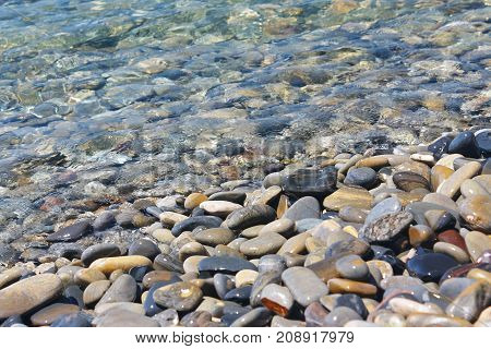 Amazing sea pebbles under water on the beach