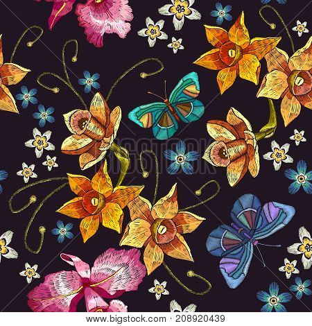 Embroidery narcissus flowers and summer butterflies seamless pattern. Classical embroidery on black background fashionable tropical template for design of clothes t-shirt design