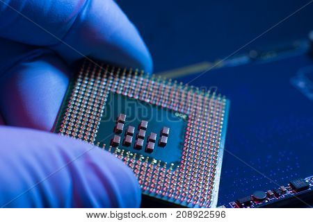 Electronic engineer of computer technology. Maintenance computer cpu hardware upgrade of motherboard component. Pc repair, technician and industry support concept