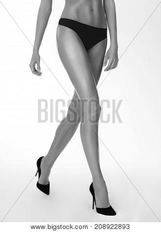 Walking long sexy legs and high heels monochrome shot