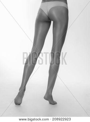Ideal Long Legs. Back view. Monochrome Shot.