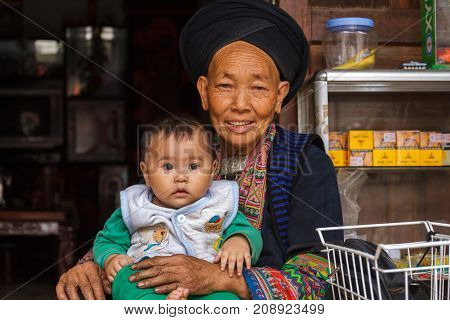 Hmong Hill Tribe Woman And Child In Ha Giang, Vietnam