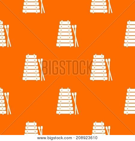 Xylophone and sticks pattern repeat seamless in orange color for any design. Vector geometric illustration