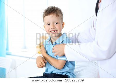 Female doctor using a digital tablet, close-up of hands. Health care concept or children's therapy.
