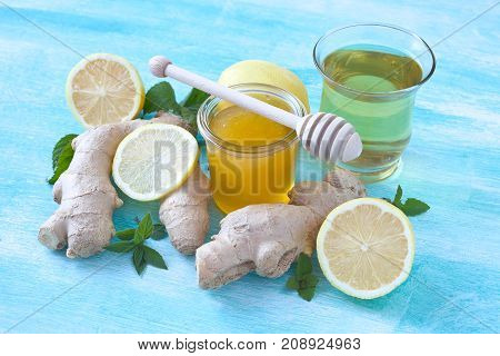 Natural cold and  flu remedy: honey, lemon and ginger.