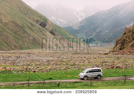 Truso Gorge, Georgia - May 21, 2016: Mitsubishi Delica Space Gear on country road in summer mountains landscape. Delica is a range of trucks and multi-purpose vehicles produced by Mitsubishi Motors.
