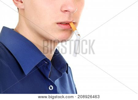 Part Face of the Teen with a Broken Cigarette in a Mouth on the White closeup
