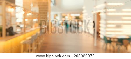 Blurred background - Coffee shop in building blur background with bokeh. Vintage filtered image. Panoramic banner background.