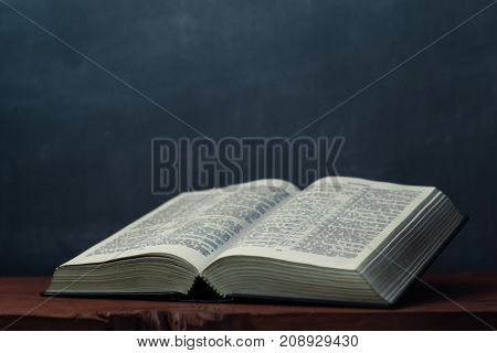 Bible on an old table. Beautiful background.Religion concept.