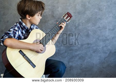 Teenage Boy Playing His  Guitar