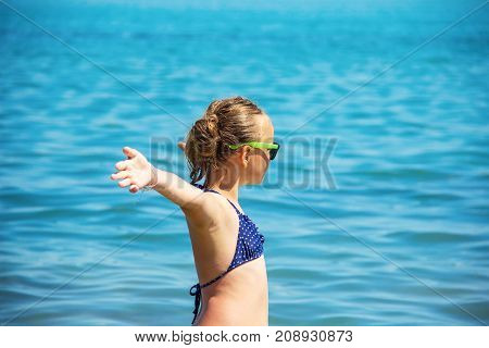 beautiful girl smile with raised hands woman on beach summer vacation. concept of freedom travel