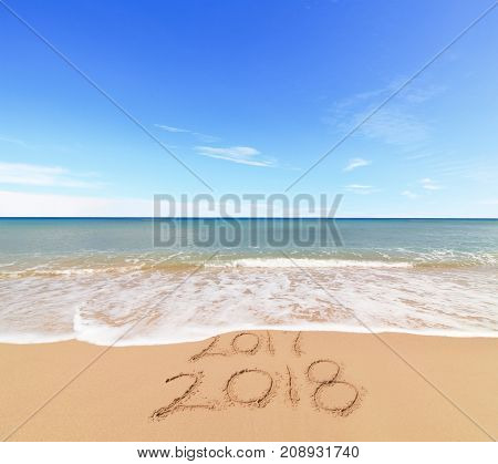 New Year 2018 coming concept - the wave is covering digits 2017
