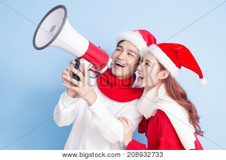 couple smile and take microphone with merry christmas