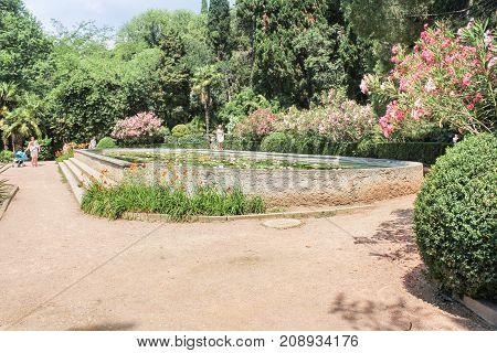 Yalta, Crimea - 11 July, Decorative pond of the botanical garden, 11 July, 2017. Lush vegetation of the Nikitsky Botanical Garden in the Crimea.