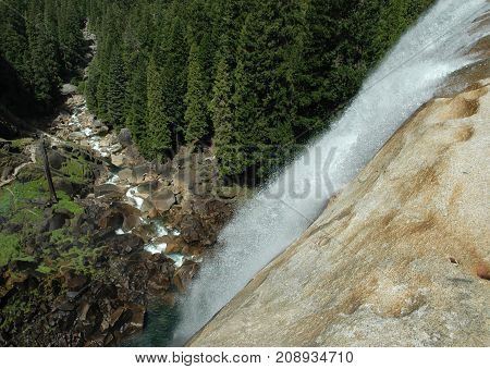 Waterfall and River Below in Sierra Nevada Mountains shot from Aerial View