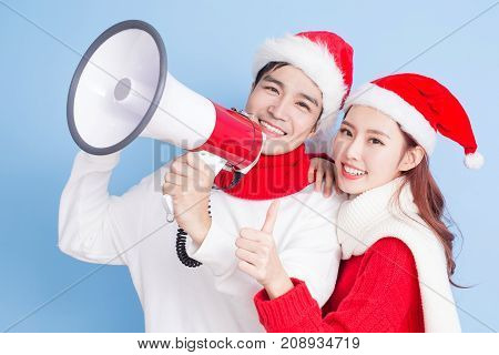 couple thumb up and take microphone with merry christmas