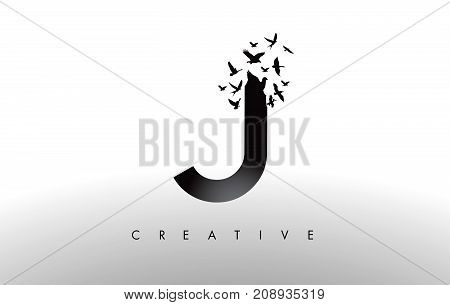 J Logo Letter With Flock Of Birds Flying And Disintegrating From The Letter.
