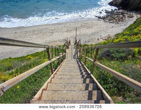 Steel Staircase Descends on to California Beach with Sand and Sea