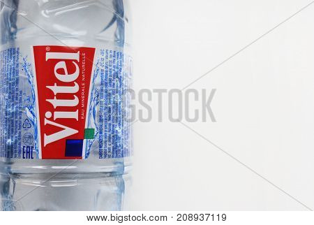 MOSCOW, RUSSIA - OCTOBER 9, 2017: Vittel Mineral Water in Plastic Bottle. Vittel is a French brand of bottled water popular worldwide. Bottle of water isolated on empty white copy space background.