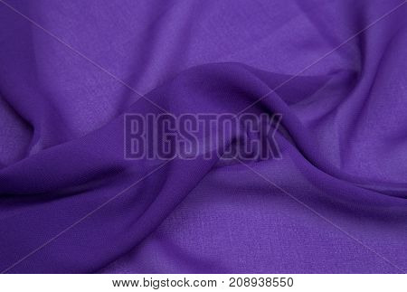 lightweight fabric of purple draped with pleats for background